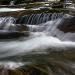 water flowing at flat rocks photo